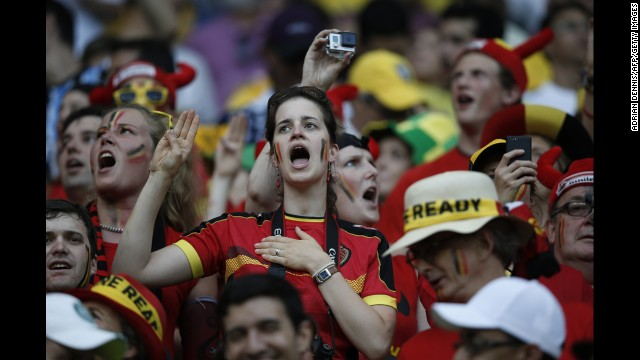 Belgium supporters cheer for their team.