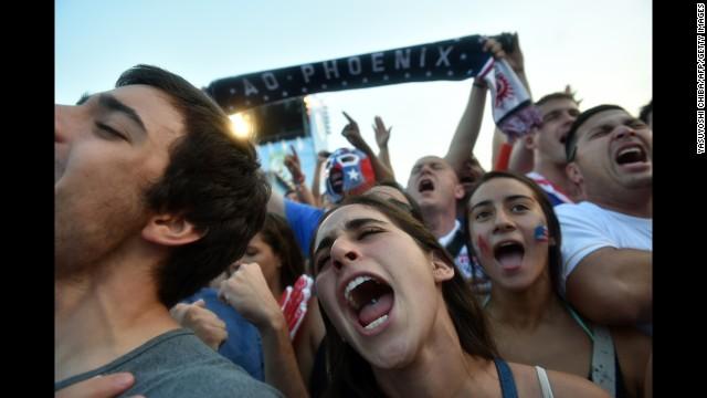 U.S. fans react as they gather to watch the match at Copacabana beach in Rio de Janeiro.