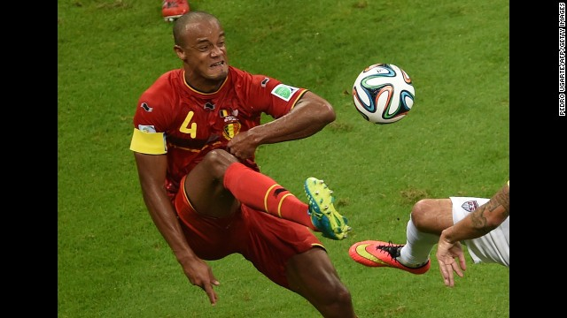 Kompany plays the ball during the first half.