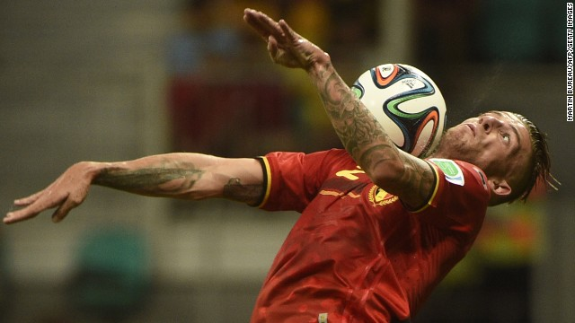 Belgium defender Toby Alderweireld controls the ball on his chest.