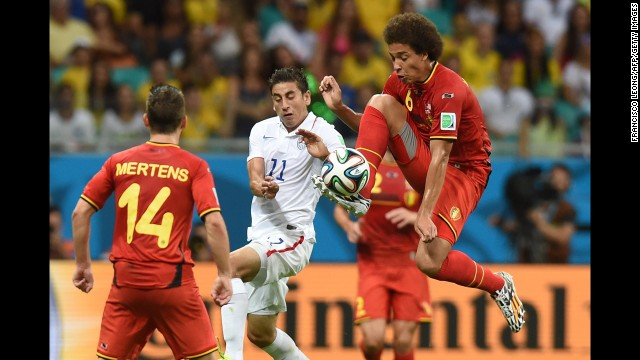 U.S. midfielder Alejandro Bedoya, center, vies for the ball with Witsel.
