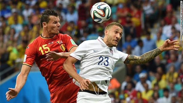 Belgium defender Daniel Van Buyten, left, fights for the ball against U.S. defender Fabian Johnson.