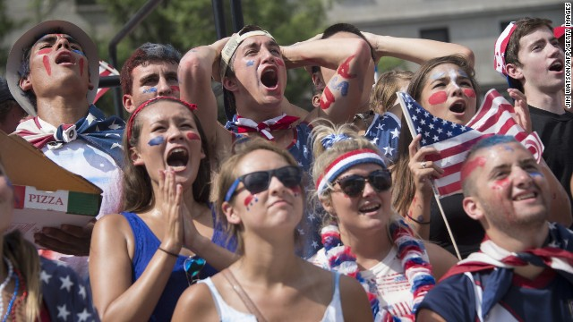 Fans in Washington react as they watch the match.