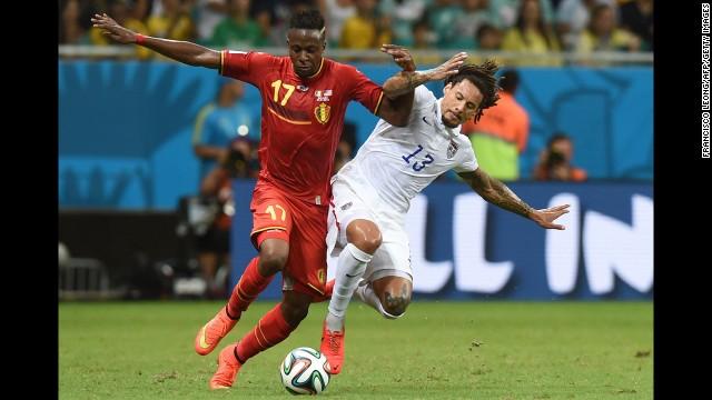 Belgium forward Divock Origi fights for the ball with Jones.