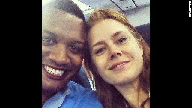 """Journalist Ernest Owens <a href='https://twitter.com/MrErnestOwens/status/482588663121858560/photo/1' target='_blank'>tweeted a selfie</a> with actress Amy Adams on Friday, June 27. """"Told @InsideEdition why Amy Adams was classy for giving up her 1st class seat to the soldier sitting next to me!"""" he wrote."""