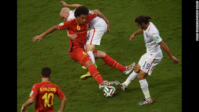 U.S. midfielders Michael Bradley, second from right, and Graham Zusi, right, compete against Witsel.