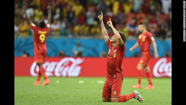 Belgian midfielder Axel Witsel, foreground, celebrates his team's victory.