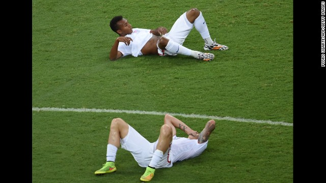 U.S. players Julian Green, top, and Geoff Cameron lie on the field after the match.