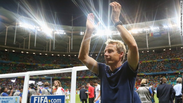 United States head coach Jurgen Klinsmann applauds the fans after losing to Belgium in a World Cup round-of-16 match Tuesday, July 1, in Salvador, Brazil. Belgium won 2-1 in extra time to advance to the quarterfinals of the soccer tournament. The United States is out of the competition.