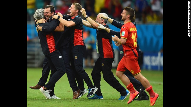 Head coach Marc Wilmots of Belgium, second from left, celebrates after defeating the United States.