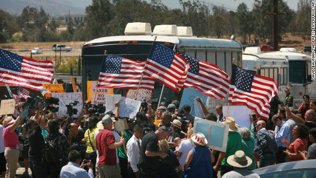 Showdown: California town turns away buses of detained immigrants