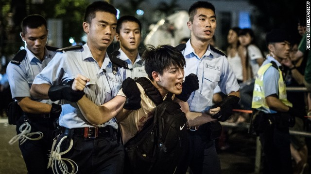 Tens of thousands of demonstrators marched during a pro-democracy rally in Hong Kong on Tuesday, July 1, to express frustration over the influence of Beijing on the city. More than 500 people were arrested during a sit-in after the march.