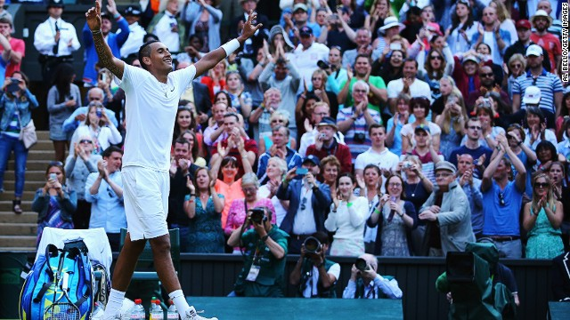 Australia's Nick Kyrgios celebrates after winning his fourth round match against Rafael Nadal at Wimbledon.
