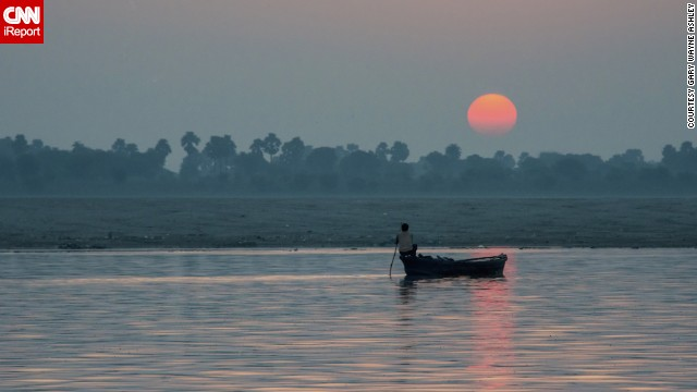 "<a href='http://ireport.cnn.com/docs/DOC-953637'>Gary Ashley </a>said this sunrise over India's Ganges River was ""a sight that remained etched in his mind."" He captured this image during a late summer vacation to the ancient spiritual center of Varanasi."