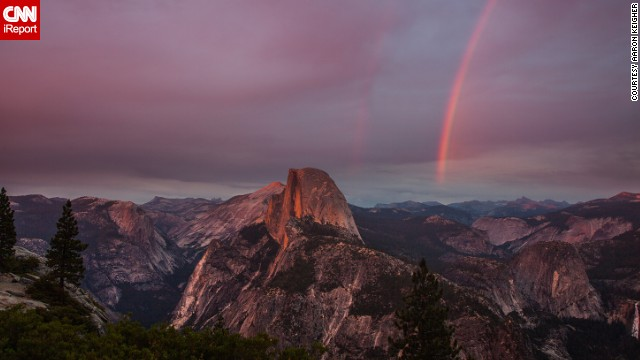 "Yosemite National Park's Glacier Point overlook is <a href='http://ireport.cnn.com/docs/DOC-1004214'>Aaron Keigher's</a> ""favorite place in the world."" It's not hard to see why when you look at this double rainbow beside the park's iconic Half Dome."