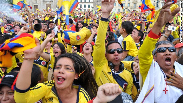 Colombian fans in Bogota burst into celebration as Rodriguez scores arguably the best goal of the tournament against Uruguay.