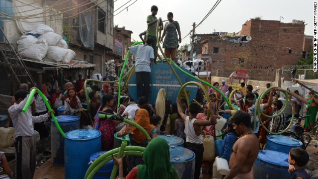 Residents fill drums from a water distribution tanker in New Delhi on June 16. Water shortages are a continuing problem in much of India, as around 150 million people have no access to clean water, according to government data.