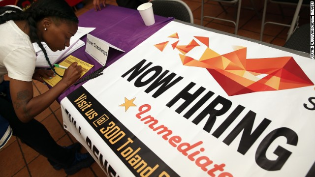 A job seeker fills out an application during a career fair in San Francisco.
