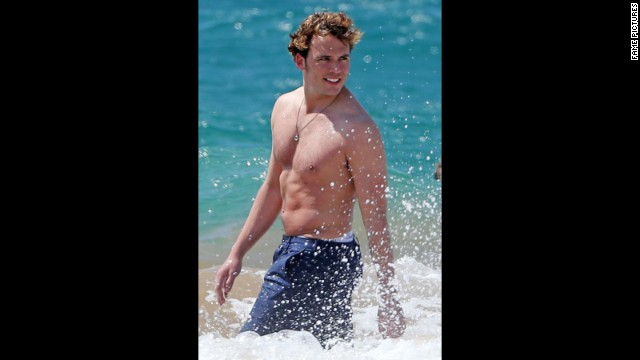 "Sam Claflin channeled his water-loving ""Hunger Games"" character Finnick Odair while vacationing in Hawaii in April 2014."