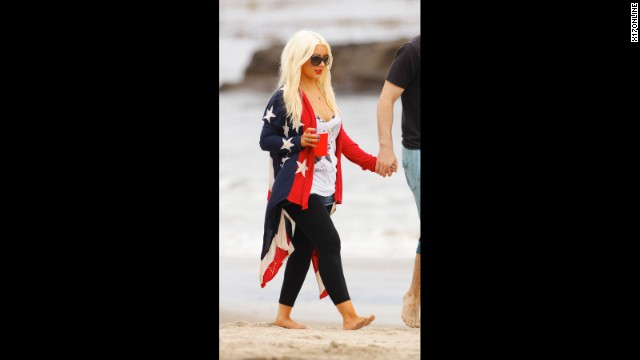 Christina Aguilera wraps herself in a more comfortable version of the U.S. flag for Independence Day 2012.