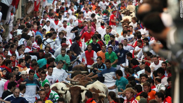 Fighting bulls from the El Ventorrillo ranch run in the middle of a street packed with thousands of runners on July 9, 2009 in Pamplona, Spain.