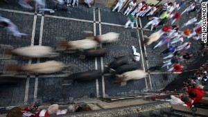 Runners entering the bullring in Pamplona.