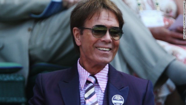 Pop singer and avid tennis fan Cliff Richard watches the Wimbledon action from the Royal Box.