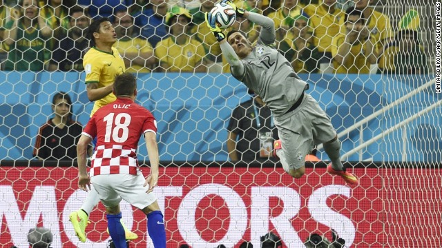Julio Cesar makes a fantastic save to keep Croatian forward Olic from putting the ball into the back of the net in the opening game of the 2014 World Cup