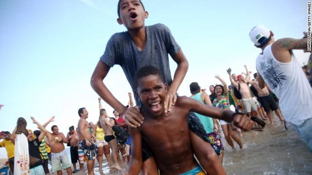 Brazilian fans celebrate on Copacabana beach after that nerve-wracking penalty shoot out win over Chile.