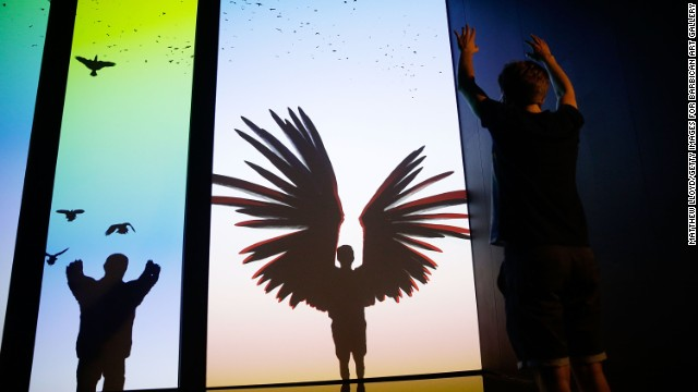 Participants take flight on virtual wings in immersive installation 'The Treachery of Sanctuary' on display at the Digital Revolution exhibition.