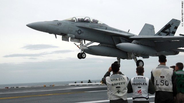 An F/A-18 Hornet is pictured aboard the USS George H.W. Bush on May 19, 2009. The F/A-18 Hornet, a late-'70s contemporary of the Air Force's F-16 Fighting Falcon, became the workhorse of U.S. carrier-based air power, and still supplements the Navy's and Marines' more current fleet of F/A-18E and F/A-18F Super Hornets. It is designed as both a fighter and attack aircraft.
