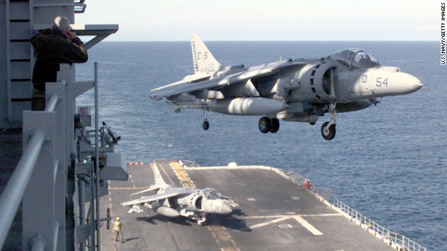 A AV-8B Harrier lands on board the USS Nassau on April 14, 1999, following a strike mission into Kosovo. The AV-8B Harrier is a single-engine ground-attack aircraft capable of vertical or short takeoff and landing. Though production of the aircraft ceased in 2003, the U.S. Marine Corps is looking at systems enhancements and plans to continue using Harriers well into the next decade.