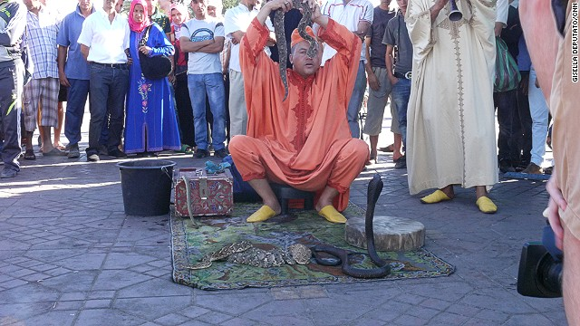 Another familiar sight in Jemaa el-Fna are snake charmers, who play rhaita flutes to mesmerize their captive cobras.
