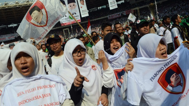 Members of an Islamic party supporting presidential candidate Prabowo Subianto attend a campaign rally in Jakarta on June 22. For his supporters, Prabowo has the qualities of a firm and decisive leader.