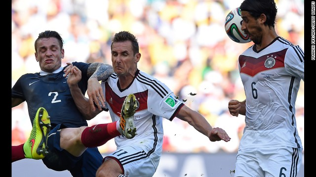 From left, French defender Mathieu Debuchy, Klose and Khedira compete for the ball.