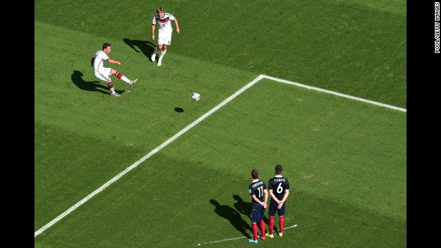 Germany's Mesut Oezil takes a free kick.