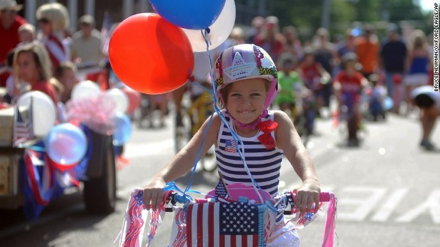 Georgia Love Greenlee Doty rides her bike in the Fourth of July parade in Oxford, Mississippi.