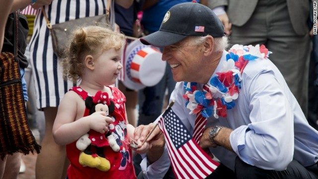 U.S. Vice President Joe Biden greets a young spectator as he marches in an Independence Day parade in Philadelphia.