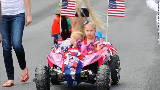 Zoe Webber drives a dune buggy with Jaxon Fanelli on board during the annual Baby Parade in Port Carbon, Pennsylvania.
