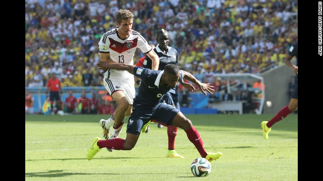 Germany's Thomas Mueller, left, and France's Patrice Evra compete for the ball in the second half.