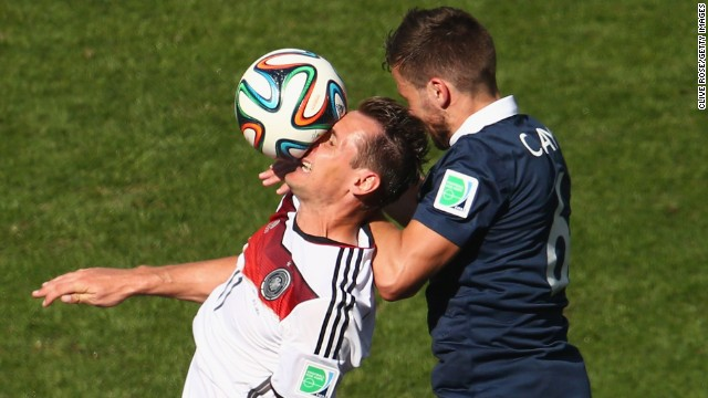 Germany's Miroslav Klose, left, and France's Yohan Cabaye go up for a header.