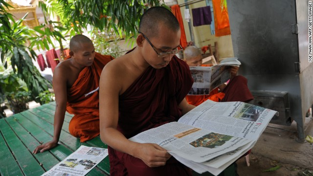Buddhists monks read newspapers at a monastery in Mandalay. Radical Buddhist monks, including the nationalist 969 Movement's spiritual leader Ashin Wirathu, have been accused of helping to incite the violence.