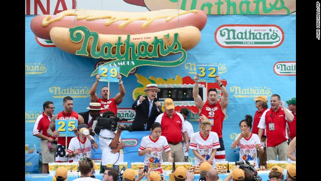 The women's competition was held earlier in the day. Miki Sudo, second from right, won by eating 34 hot dogs.