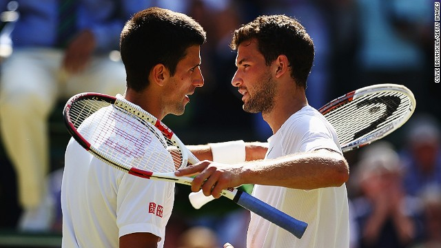Djokovic and Dimitrov embrace at the end of their Wimbledon semifinal match.