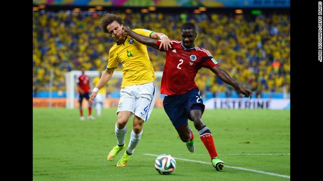 David Luiz, left, and Colombia's Cristian Zapata compete for the ball.