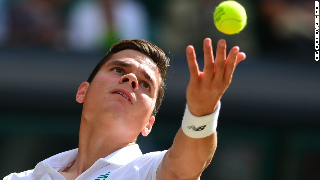 Milos Raonic serves during the first set his semifinal encounter with Roger Federer at Wimbledon. The young Canadian showed nerves early on but steadied as the first set went on.