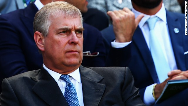 Prince Andrew graces Centre Court with is royal presence, although he looks less than impressed.