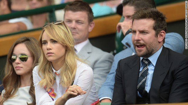 Not quite so Royal but not quite so unimpressed. Bradley Cooper watches on with his girlfriend, British model Suki Waterhouse.