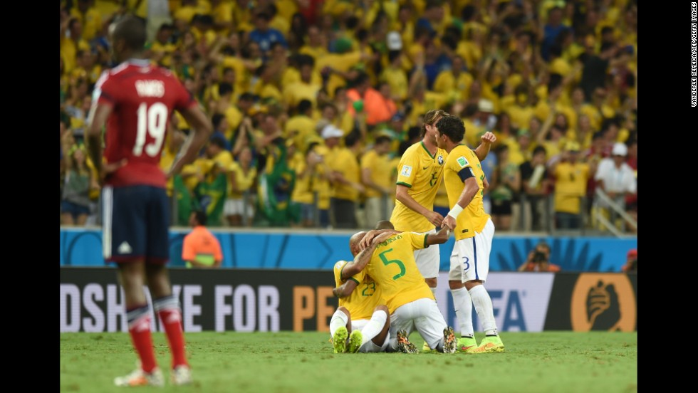 Brazil's players celebrate after winning the quarter-final football match between Brazil and Colombia on Friday, July 4. Brazil won the match 2-1 and advanced to the semifinals of the tournament.
