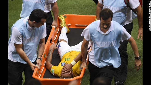 Brazil forward Neymar is carried on a stretcher after being injured following a tackle.